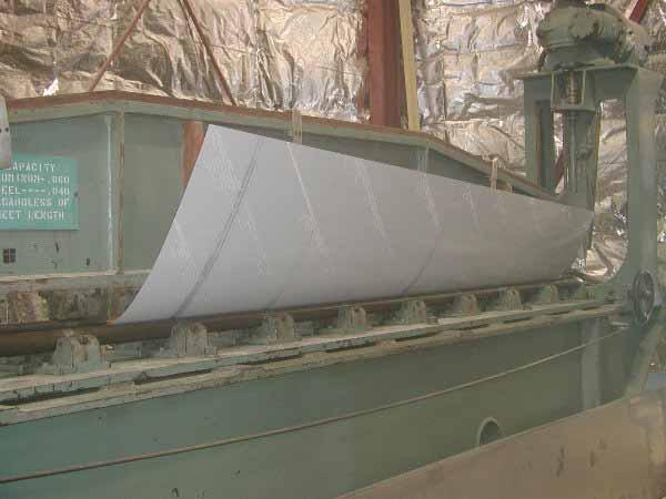 Forming sheet metal aircraft leading edge.