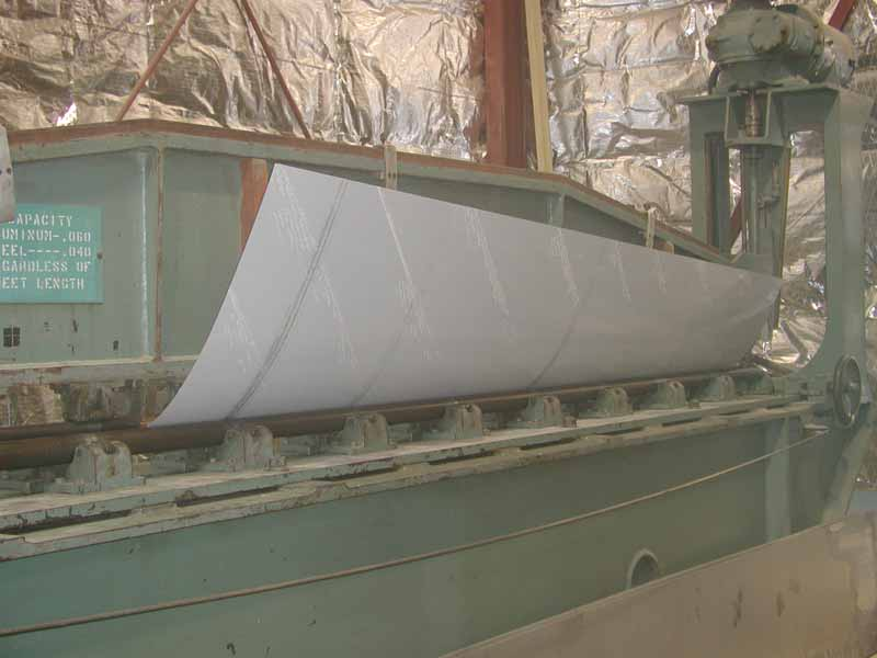Rolling a sheet metal part using the Farnham Countour Roll.